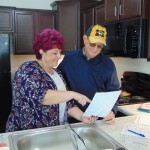 GETTING THE GRAND TOUR, Joe Dale Hedrick attended Friday's open house at Harbor West Senior Villas in Warsaw. Hedrick was shown one of the striking new units by Property Management Specialist Carri Eisenhauer.