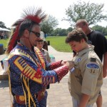 DRAKE HARBOR SET THE SCENE for Boy Scout Troop #34 on Sunday with a colorful Court of Honor Ceremony. Retiring Scout Leader Kevin Dockery presented Dennis Weiske with his Tenderfoot Rank.