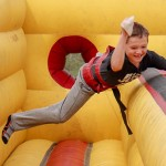 A PARTY WITH A PURPOSE, Easton Bagley rocketed down an inflatable ride during Saturday's annual R-IX South Elementary School Carnival. Photograph by Tyler Douglas Simons, Enerprise Staff.