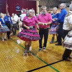 OLD TIME MUSIC AND DO-SI-DOS took center stage at the Warsaw Community Building on Saturday. Penny and David Byers were part of a four state contingent that packed the house.