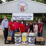 THE PANDEMIC has caused an unprecedented spike in demand at the Warsaw Food Pantry.  Benton County Elks members Chuck Allcorn, Mike Blyth, Ronald Hix and Sherry Blyth presented a sizeable food donation to Pantry representatives Jeannie Arnold, Shana DeJaynes, Susan Sullivan Robb and Brian Dowler. Allcorn also serves as Food Pantry Vice President.