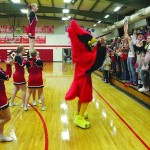 THE LINCOLN CHEERLEADERS LEAD the Lincoln pep club in a cheer during Tuesday night's home basketball game against Benton County rival, the Cole Camp Bluebirds. With five players on the court, the crowd can act as a sixth man during a game and can motivate their team to victory.