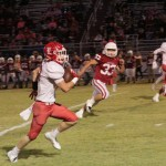 SENIOR PARKER ENGLES RACES DOWN THE SIDELINES against Tipton last  Friday night. The Lincoln Cardinals defeated the Tipton Cardinals 49-0 to remain unbeaten at 6-0 and to stay atop the Class 1 state ratings.
