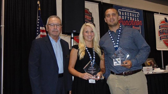 THE DIAMOND 9 AWARD was presented to Warsaw's Johnny and Kelli (Wenberg) Eierman at the Missouri Sports Hall of Fame baseball and softball luncheon last Thursday.  The Eierman's are the first husband-wife to ever receive the award.  Shown with Johnny and Kelli is the MSHOF Chairman of the Board, Kris Conley.
