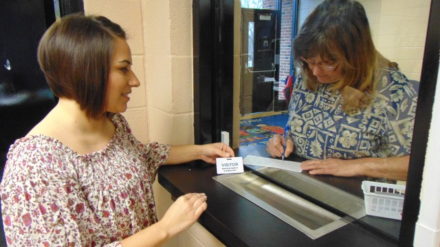 """AFTER THE SHOOTING THAT LEFT 17 PEOPLE DEAD at a Florida High School.  Benton County school officials were examining their own security measures. Visitors to Warsaw R-IX Schools are screened before being """"buzzed in.""""  Denise Reno assisted Lyla Weaver at R-IX North Elementary on Tuesday. After completing a registration form, Weaver received a Visitor Pass."""