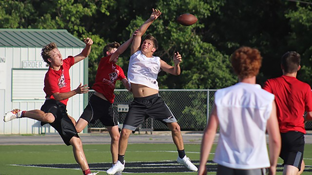 SENIOR COLBY SCHWARTZ goes up for a pass against Buffalo at the WHS scrimmage last week.