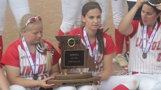 WHAT IS SOON TO BECOME A RARER SITE as Lincoln players Seniors Genesis Smith, Aleah Paxton and Lyndsey Koll are pictured with the 2019 state softball championship trophy. Lincoln had to play and defeat much larger schools in the Final Four. Most of the other sports are divided up into classifications according to enrollment. Spring softball has no classifications. MSHSAA is about to make huge changes effecting most of the other sports.