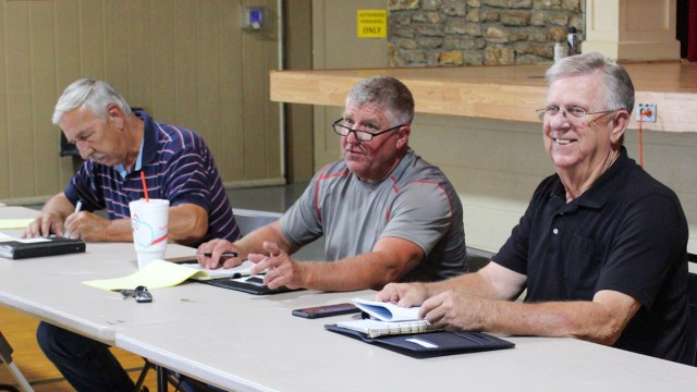 WORKING TO HELP local businesses, Benton County Commissioners David Malecki, Steve Daleske and Glen Nelson prepared for a town hall meeting at the Warsaw Community Building last Friday.
