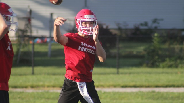 SENIOR QUARTERBACK JACKSON BEAMAN throws the football during a recent practice session. The Lincoln Cardinals are coming off an amazing 13-2 season and a runner-up for the state championship. They are ranked third in the state in the early polls.