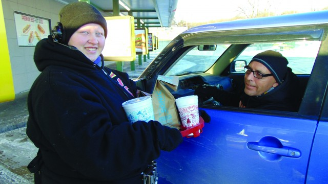 """COLD TEMPERATURES ARE JUST A PART OF THE JOB for many workers, including Warsaw Sonic car hop Casey Keith who delivered a breakfast order to Jamie Lux. She told the Enterprise, """"I bundle up as much as I can. I wear three coats, a hat, gloves and get on with it."""" The wind chill was 16 degrees below zero early Tuesday,"""