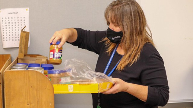 WHILE SOME STUDENTS at John Boise Middle School and Warsaw High School struggle with hunger, Middle School Counselor Katy Johnson decided to do something about it. Johnson helped open a school pantry, where she keeps the shelves stocked.