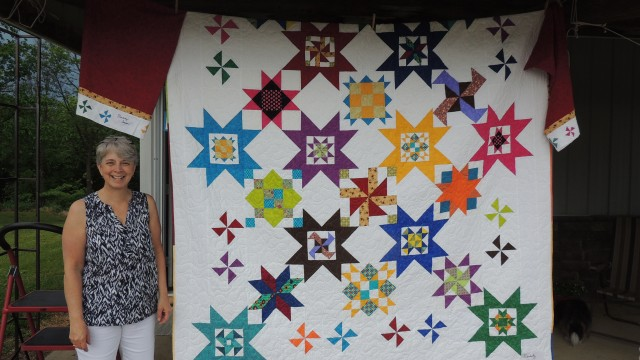 AT THE LAKE QUILT SHOP hosted a quilt show on Saturday. Proprietor Lori Vanvatte says the pattern used by all participating was Sea Stars by Turning Twenty Co. Two of Lori's friends, from Minnesota, helped put up the display. Jackie Schmick and Mary Kinish. Everyone used colors of their choice- no two turned up alike.