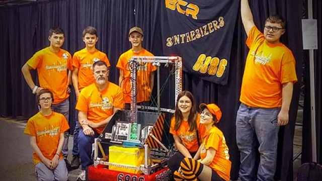 AWARD WINNERS, the Benton County 4-H Robotics Team includes front row (L) to (R) Jeremiah Daffron, Jim Kjar, Jasmine Summers and Rosie Daffron, Back row (L) to (R)  Kai Kaneko, Marcus Kjar, Jared Thomas and John Kjar,