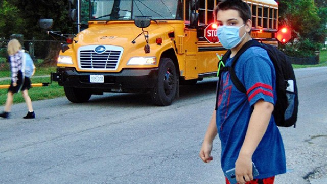 BUSES CONTINUE TO ROLL in Benton County as teachers and students take precautions to avoid contracting the coronavirus. Tyler Jones boarded a bus heading for John Boise Middle School on Tuesday morning.