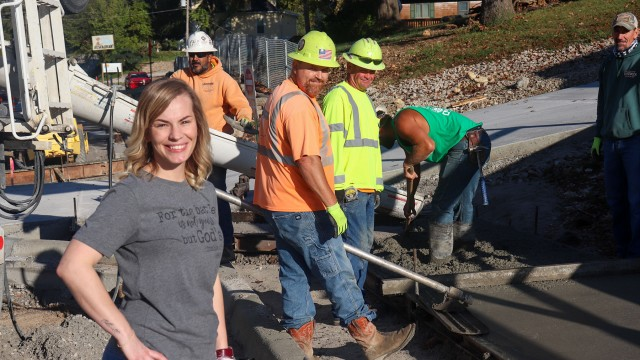 DOWNTOWN'S FUTURE IS A STEP AWAY with street and sidewalk renovations being completed on upper Main Street. Jamie Allen at Cosmic Café watched as workmen poured concrete on Monday.