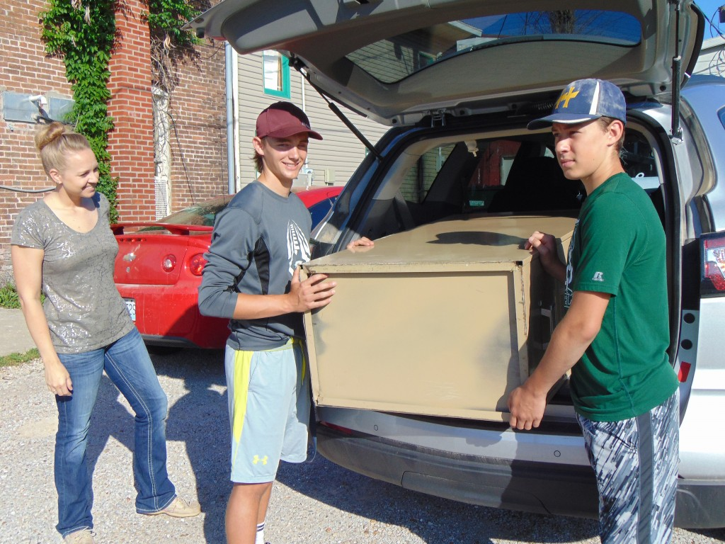 GIVING BACK TO THE COMMUNITY is a good goal for WHS Athletes.  Chase Steiner and James Kellner helped Amber Segar move a file cabinet from her Main Street office on Friday. The program helps give back to area businesses and individuals who support the WHS Booster Club.