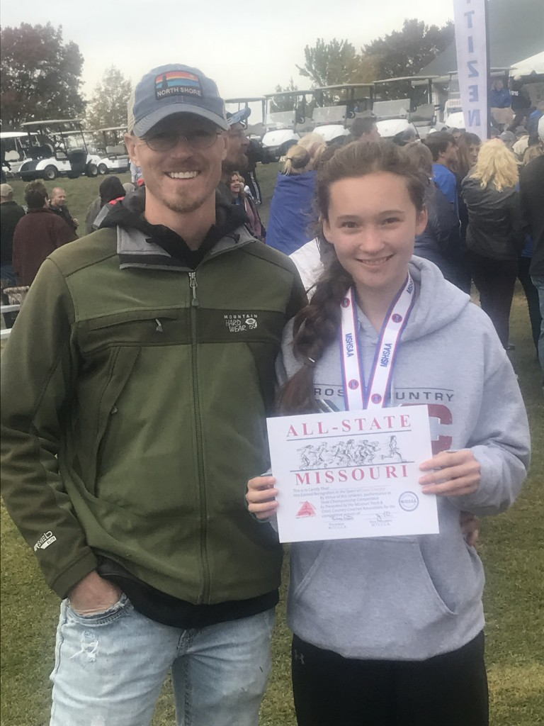 WHS CROSS COUNTRY COACH Ehren  Banfield stands proudly next to All- State Runner Alyssa Alcantara. The freshman amazingly came in 10th out of 176 girls this past week at the state meet in Jefferson City MO.