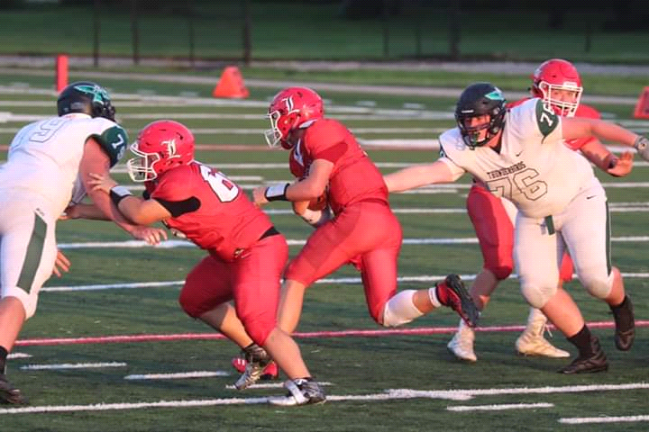 QB JACKSON BEAMAN RACES through a big hole between two huge linemen for North Calloway. Top rated Lincoln won 40-8 against the 14th rated North Calloway squad.