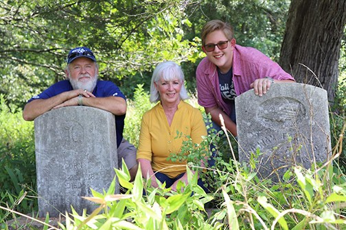 UNEARTHING THE PAST, Will Langford, Rebecca Dennis and Hunter Butler cleared debris from tombstones at Kays Plantation Cemetery near Turkey creek. Dennis and Butler are descendents of the Kays family who were early Benton County pioneers.
