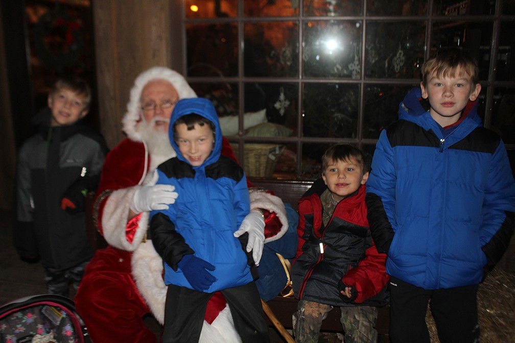 KAYSINGER BLUFF was filled with magic and light during Saturday's annual Christmas program. Connor Roberts, Brodie Campbell, Henry Adler and Quintin Campbell were part of a large crowd attending the event.