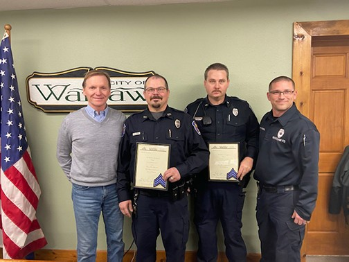 CONTINUING THEIR MISSION to protect and serve, Warsaw Police Officers Chad Eledge and Levi Ullum received their promotions to Sergeant from Mayor Eddie Simons and Chief Jason Wenberg during a ceremony at Monday's city board meeting.