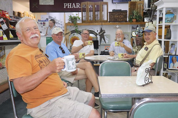 A REASSURING SIGN during these chaotic times, the Coffee Club at Boring's Drug Store on Main Street has resumed their morning meeting. Members of the storied organization include Bob Follmer, Mike Murray, Randy Eaton, Rick Bibb and Bill Hughes.