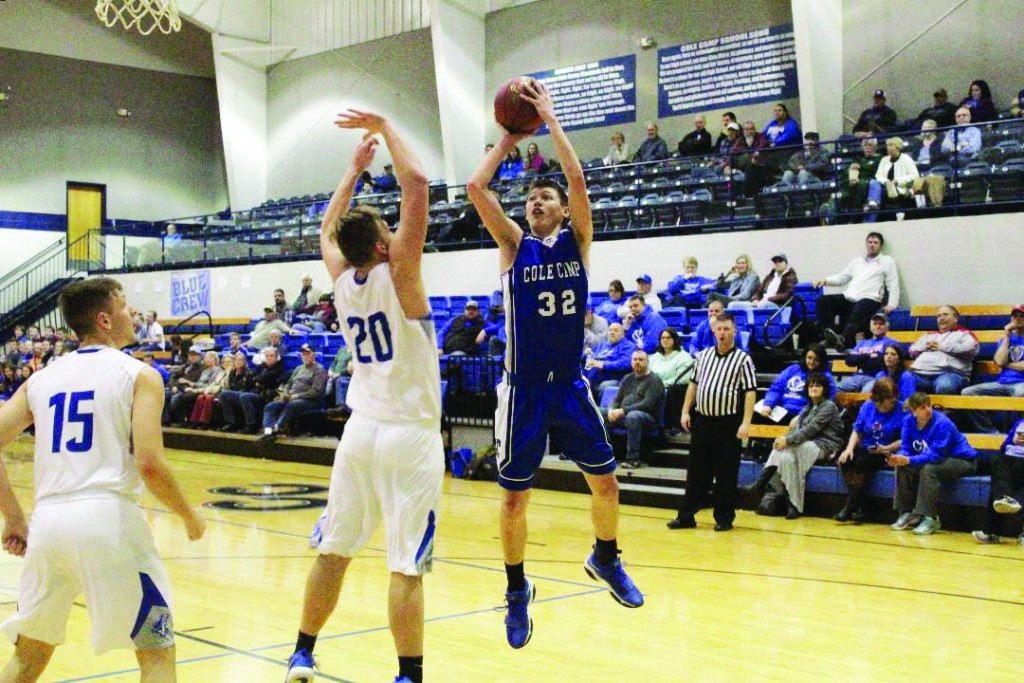PROMISING SOPHOMORE ETHAN IVES shoots over a Boonville defender in Cole Camp's 56-45 loss in the semi-finals of district play last week at Cole Camp.