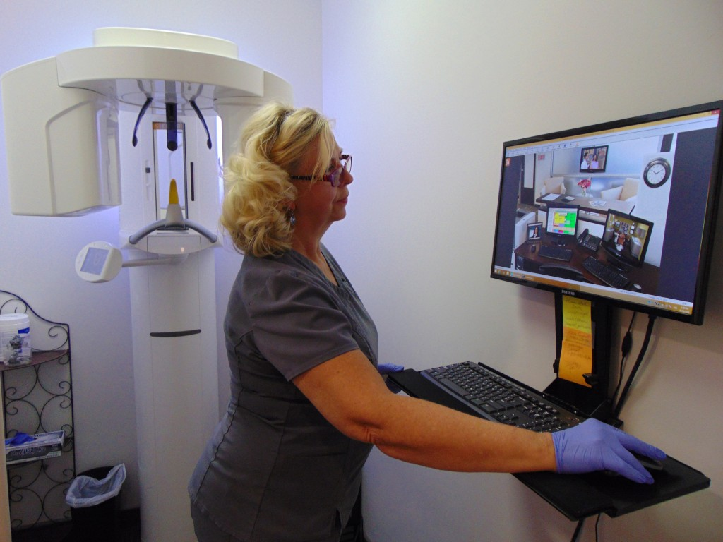 ON THE FOREFRONT of technology, Wendy West utilizes a 3D imaging device at Truman Lake Dental in Warsaw.