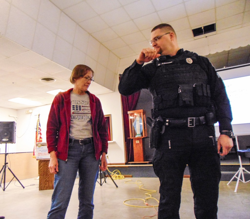 LEARNING about proper firearm retention from Warsaw Police Sergeant Grant Johnson, Kathy Freeburger attended a conceal and carry seminar on Thursday.
