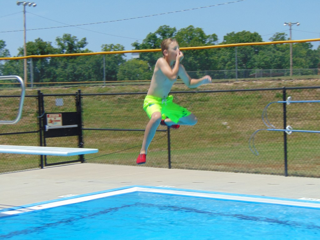 TAKING THE PLUNGE, John Cramer beat the heat at the Warsaw Municipal Pool on Monday. The facility has extended hours this season until 7:00 PM.