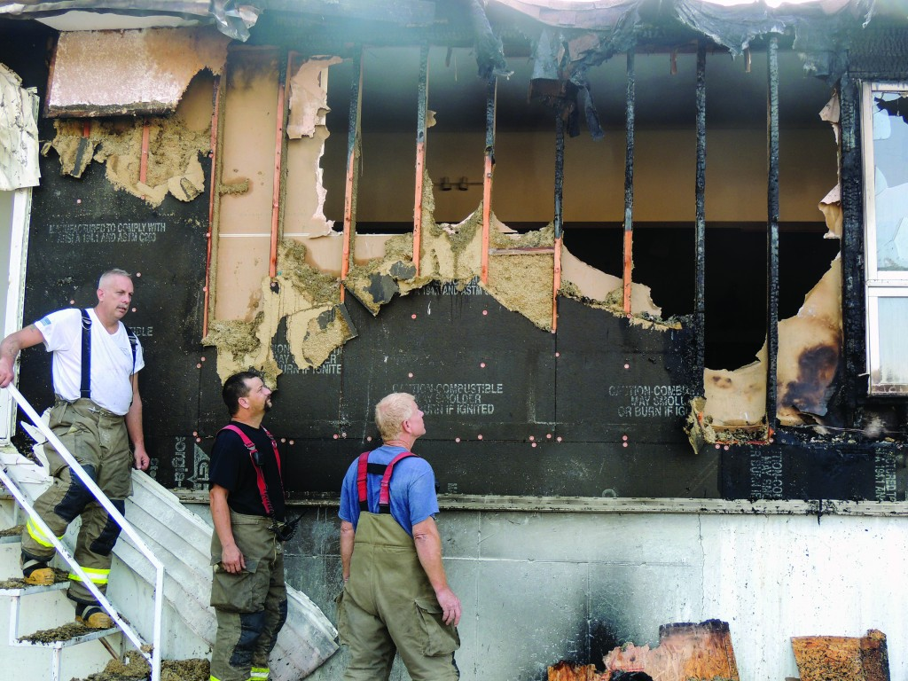 A DEVASTATING FIRE ripped through a portion of  Cedar Grove Baptist Church early Monday morning. Members of the Warsaw Fire Protection District including Bill Simmons, Ron Goodman and John Powell helped put the fire down.