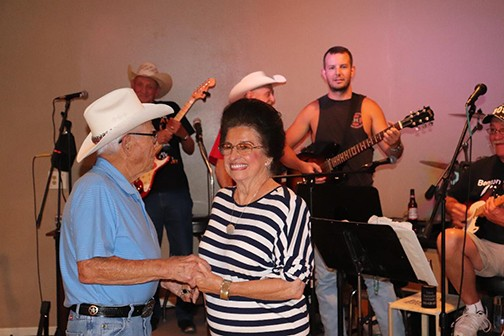 MAKING THEM FEEL LIKE DANCING, Hunter Thomas Mounce made a special appearance at the Elks Lodge on Thursday. Earlene Reser and Dean Constance were among  guests who were inspired by the music.  Mounce was backed up by the Lodge Boys Band.