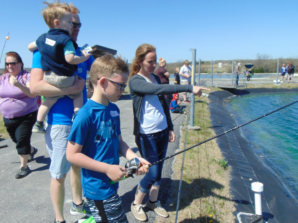 GETTING IN ON THE FISHY FUN, Keagen, Bennett, James and Carshena Mammen took part in the  annual Kid's Fishing Day at Lost Valley Hatchery in Warsaw.  The event took place on Saturday.