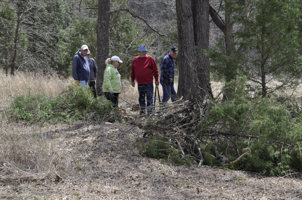 AN ANCIENT CEMETERY is being restored at Forbes development in Edwards by a volunteer group that includes John Ely, Jo Spicer and Jim Kramer.