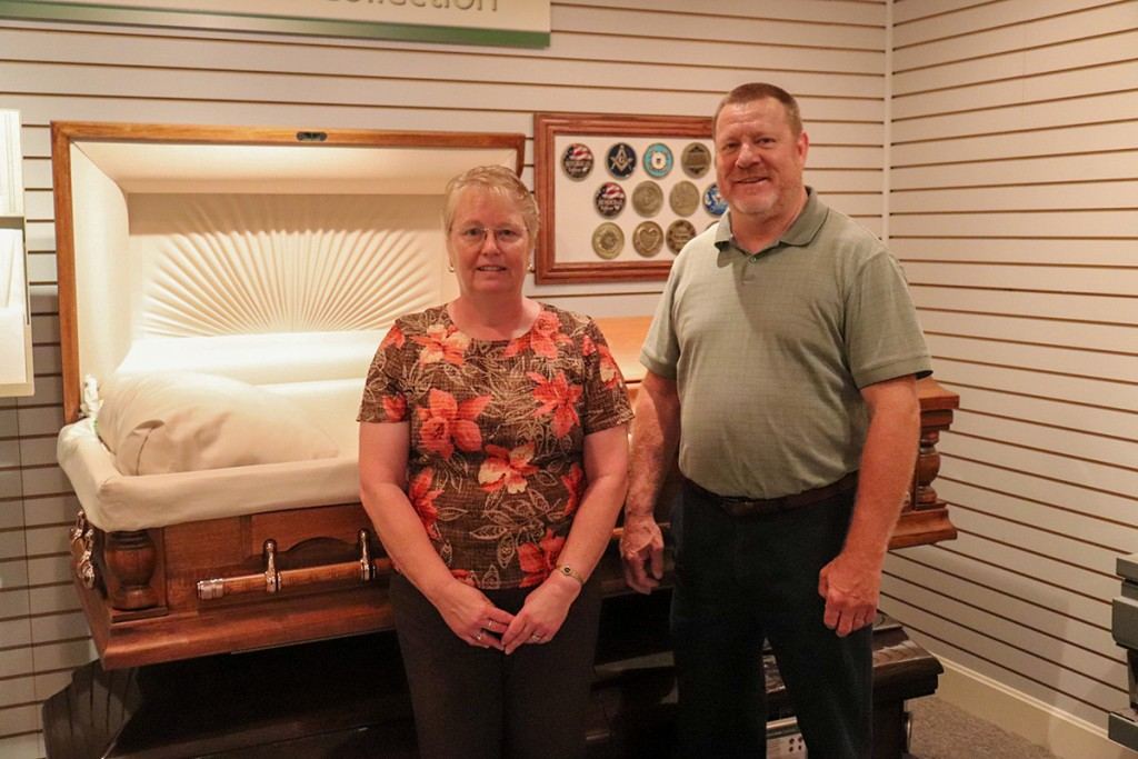 NO HUGS, but plenty of alternatives are on hand to make funerals as meaningful as possible while adhering to social distancing guidelines. Reser Funeral Home employees Debbie Stowe and Paul Eason have adjusted to a new normal when planning services.