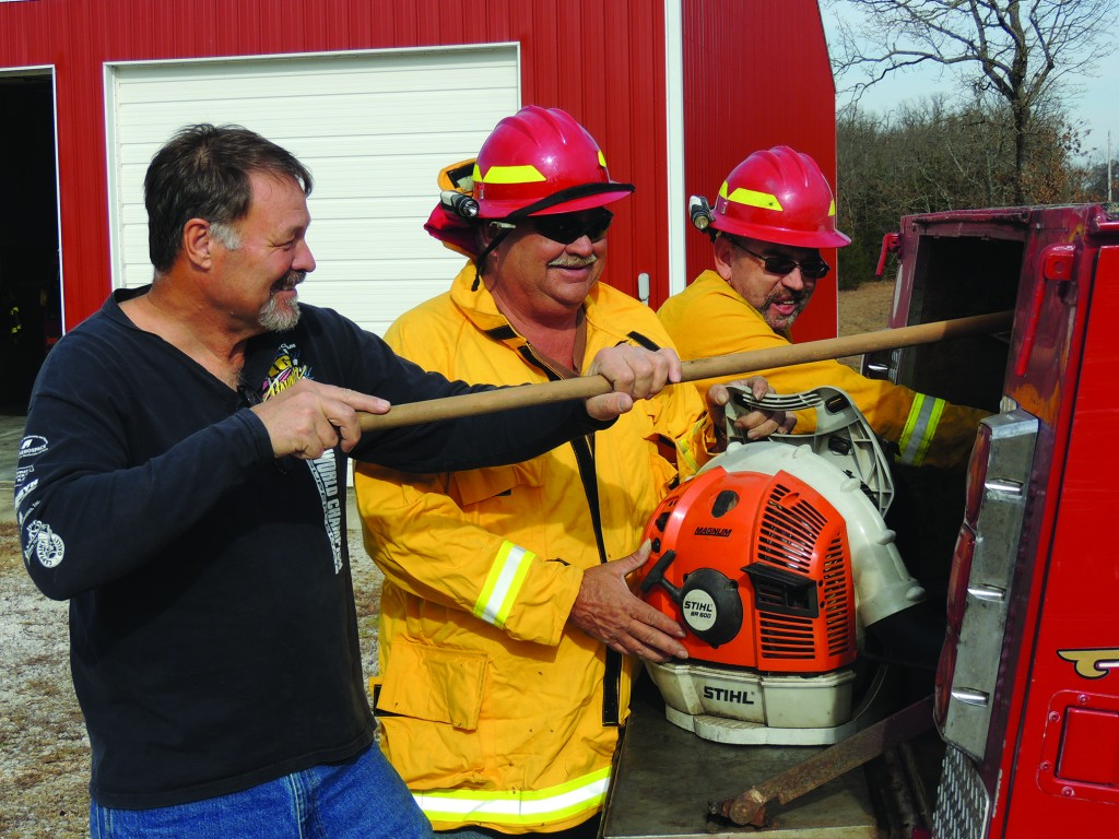 VOLUNTEER FIREMEN HELP SAVE LIVES AND MONEY in rural communities, including Gary Batson, John Spry and Chad Hammond who returned from a fire call Monday afternoon in Edwards. The trio are part of the Deer Creek Volunteer Fire Protection District.