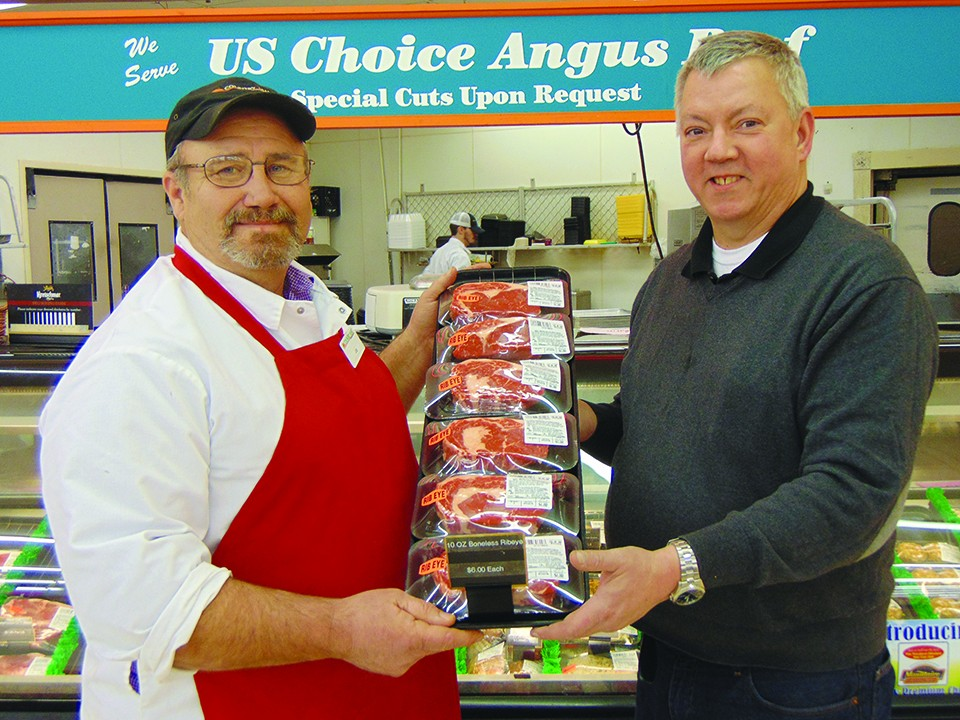 WELL KNOWN FOR QUALITY MEAT, Joe Hubbard and G&W Foods Manager Bill Marks are proud of the store's selection of USDA Choice meat.