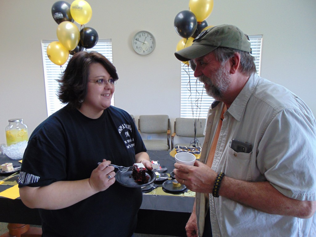 CELEBRATING A LONG CAREER  of service to Benton County, Mark Grenoble greeted guests including Brenda Hillburn at a retirement reception in his honor last Friday.