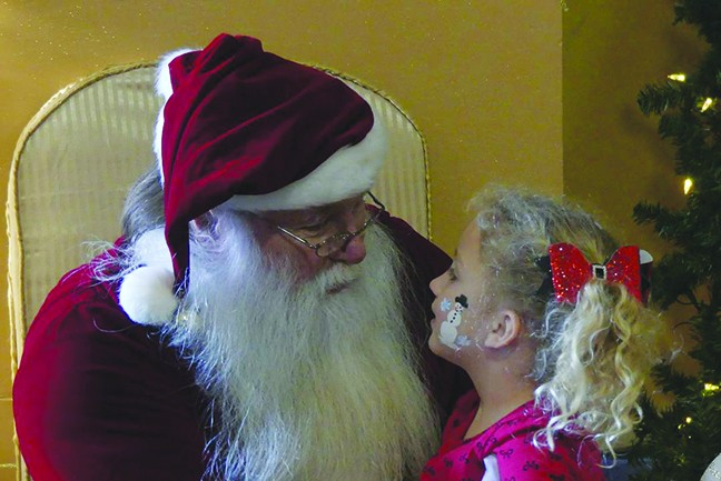 "CHRISTMAS CHEER filled Warsaw on Saturday with jam packed events that included breakfast with Santa at the Community Building. Gracie Tharaldson gave the ""Big Guy"" her list."
