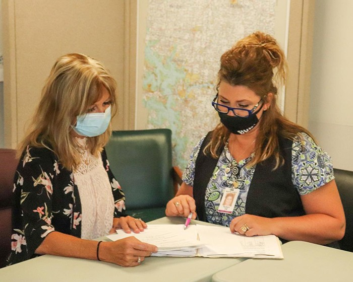 KEEPING A WATCHFUL EYE  on the ever-changing pandemic landscape, Benton County Health Department Director of Nursing Tammie Heimsoth and Public Health Nurse Barbara Schroder use a daily flow chart to track cases.