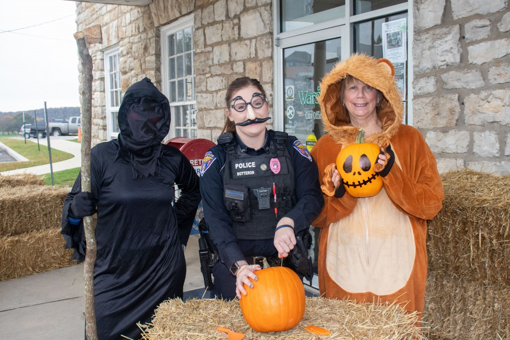 BOO TO YOU! Jenn Bradshaw, Officer Chasady Botteron and Heidi Lee carved pumpkins to celebrate this week's Chamber sponsored Halloween Hoopla and City of Warsaw sponsored costume contest.