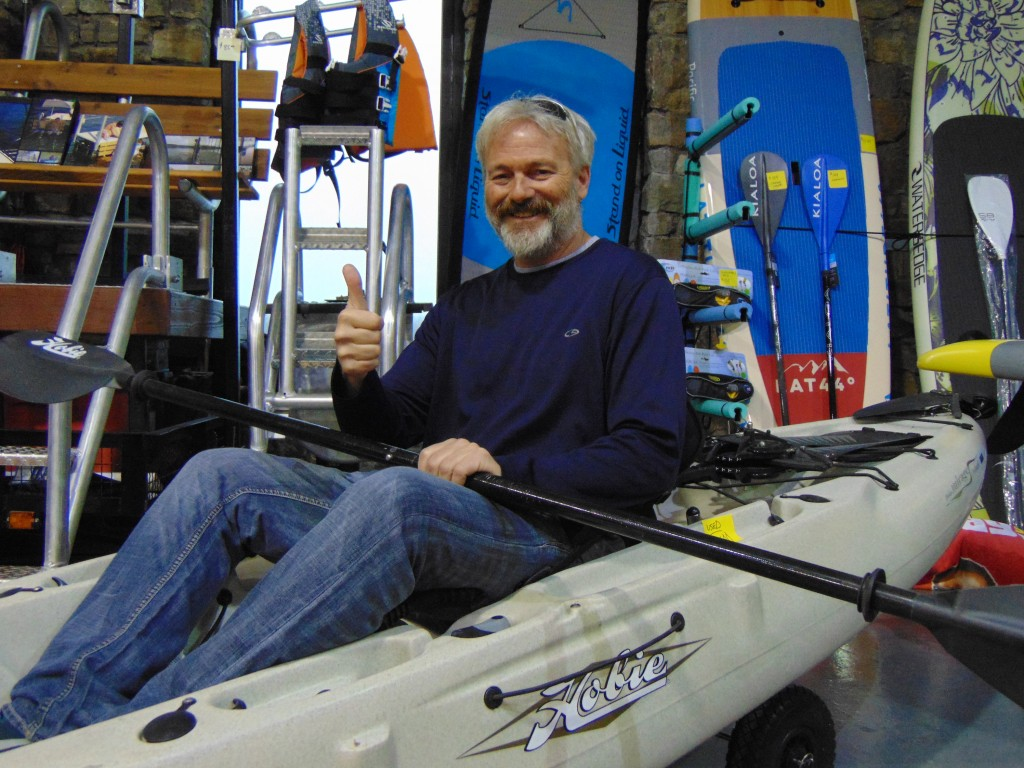 """THINKING SPRING, Joey Jelinek took a """"virtual reality"""" ride on a kayak during Saturday's Lake Life Hunting and Fishing Show at the Warsaw Community Building. The event was hosted by the Warsaw Area Chamber of Commerce."""