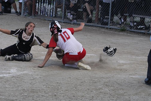 HALEY EBELING SLIDES PAST Adrian catcher Mckenna Hummell in Monday's sectional matchup. Lincoln won 12-5 and will host Willington - Napeoleon on Thursday night.