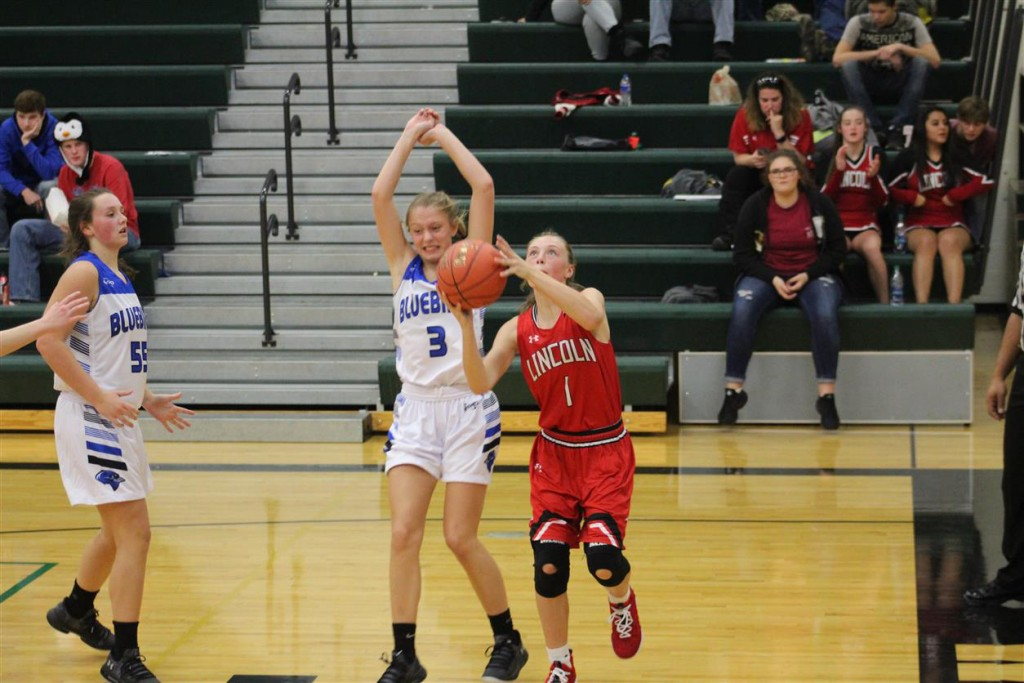COLE CAMP SENIOR TALYER GUDDE tried not to foul Lincoln's Freshman Jenna Vandaveer as she put up a shot during Monday night's WHS tournament action.