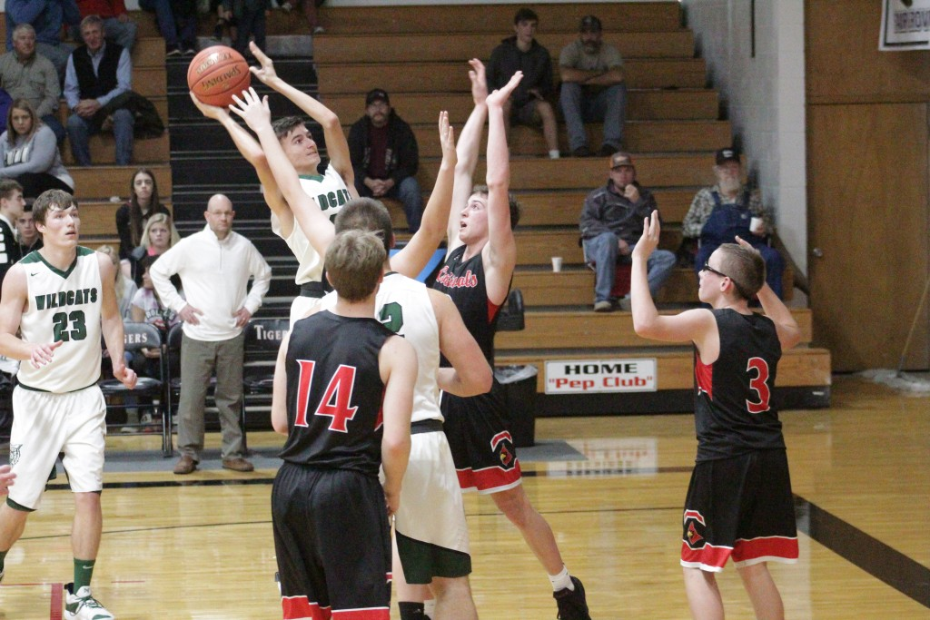 WARSAW'S PARKER LOVE GOES up high for a shot against Halfway in the Skyline Tournament last Thursday night. Warsaw won the semi-final matchup 80-41.