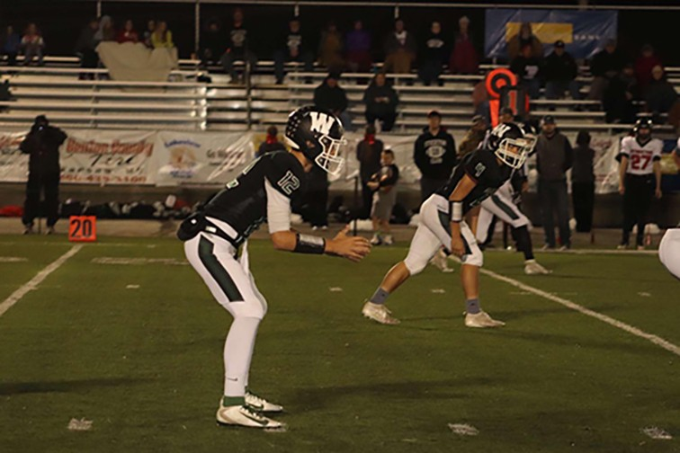 TAKING COMMAND OF THE WARSAW OFFENSE, senior quarterback Matt Couzens led his team to a 52-26 home win over Stockton last Friday to advance to the district semifinals where they'll face the Lamar Tigers this week.  Couzens tossed 3 touchdown passes in the game.