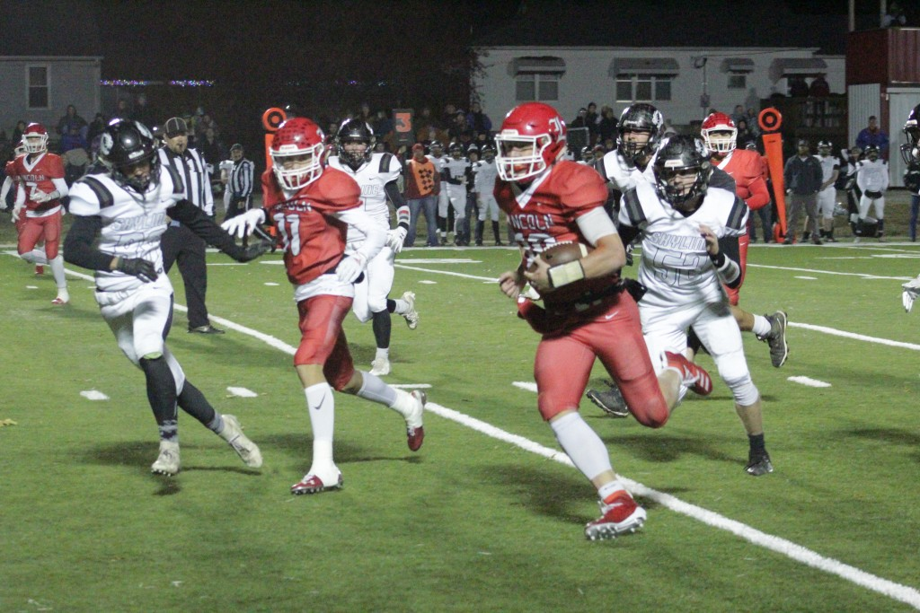 IT WAS CATCH ME IF YOU CAN AS LINCOLN QUARTERBACK JACKSON BEAMAN outran would be tacklers with great blocking all night long as Lincoln beat Skyline 42-13 to claim their fourth straight district championship.. They will travel to Windsor on Saturday.