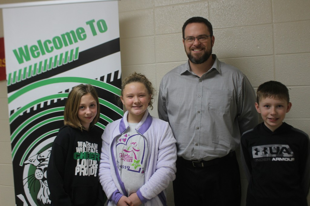 ON THE MOVE, Warsaw R-IX North Principal Caleb Petet will become Superintendent of Schools for the R-IV District in Climax Springs next year. Petet is pictured with North School 5th graders Shilah Hart, Karly Keele and Connor Callister.