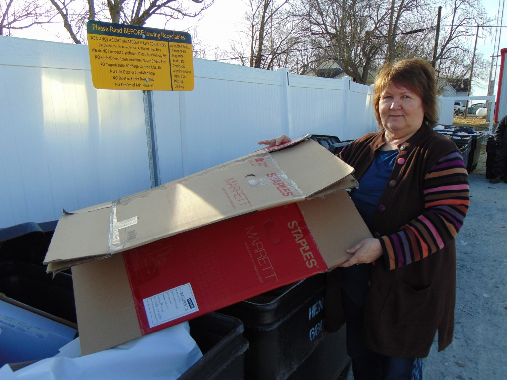 DOING HER PART to help the environment, Ruth Eckhoff dropped off cardboard at Lincoln's recycling center on Monday. The facility is located by the Main Fire Station.