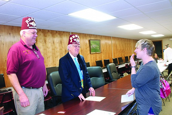 ON A MISSION, Warsaw Shrine Club member Chuck Allcorn and Shriners Hospital Chairman Wayne Spencer spoke at Warsaw R-IX High School on Friday about a program to help local kids with medical care. Attending the event was Tricia Binnie.
